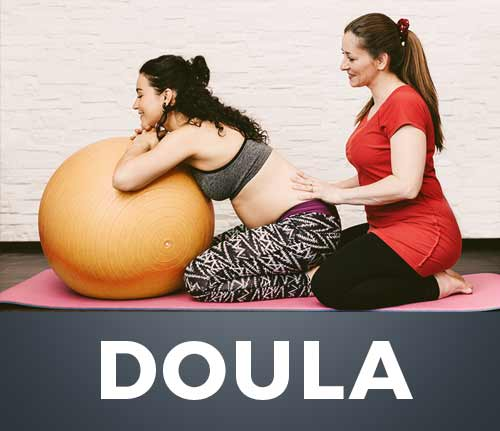 doula helping pregnant woman