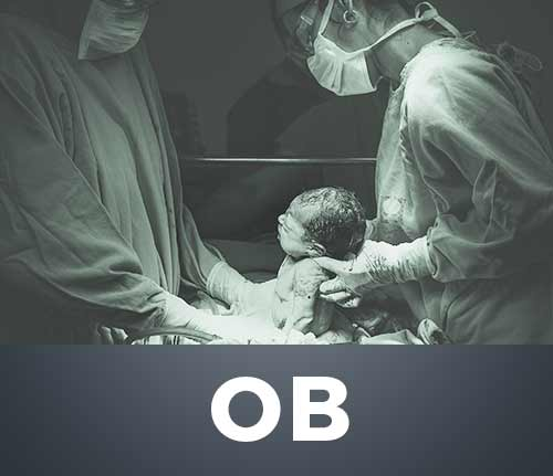 ob surgeon pulling new baby from abdomen
